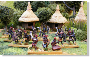Some of James Morris' Azande Army for Death in the Dark Continent, stood in front of his superb scratch built Azande Village.