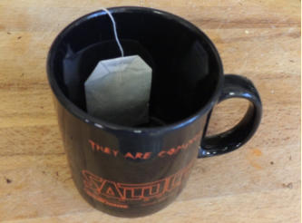 We say 'cup', but actually mean a Mug. Cups are for sissys, and saucers just invoke the ancestral spirit of Ned Ludd in us. So get a good mug, take the teabag out of it's sachet, unravel the string and drop the bag into the mug. Make sure the bag's string